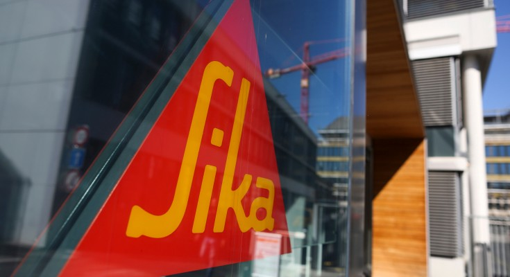 A sign hangs in the window at a Sika AG adhesives and cement manufacturing facility in Zurich, Switzerland, on Monday, Sept. 7, 2015. Sika's founding Burkard family remains committed to selling its $3 billion-stake in the adhesives maker against the company's will, saying it would be impossible to go back on the deal with Cie. de Saint-Gobain SA even if they wanted to. Photographer: Chris Ratcliffe/Bloomberg